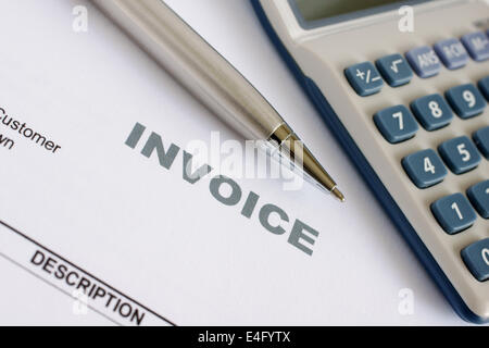 Invoice letter head with pen and calculator - Stock Photo
