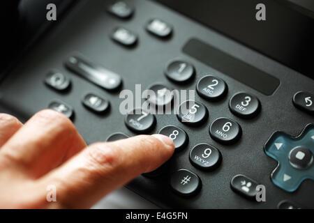 Dialing telephone keypad - Stock Photo