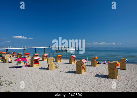 Roofed wicker beach chairs at Timmendorfer Strand / Timmendorf Beach along the Baltic Sea, Ostholstein, Germany - Stock Photo