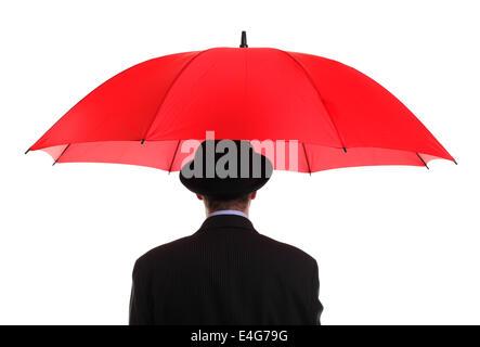 Businessman holding a red umbrella - Stock Photo