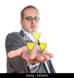 Business man reaches out his arm with a radioactive symbol floating over his hand. Isolated on White Background - Stock Photo