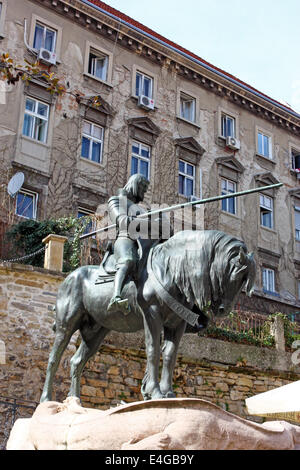 St. George after the battle with the Dragon, sculpture - Stock Photo