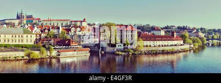 Vintage retro hipster style travel image of panorama of historic center of Prague:  Gradchany (Prague Castle) and - Stock Photo