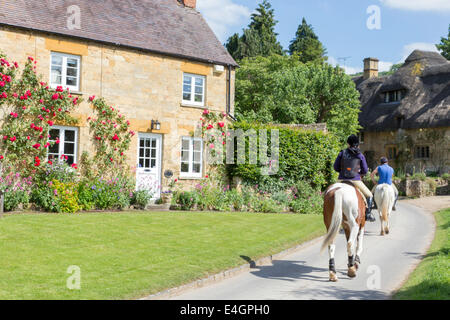 Horse riding in the Cotswold village of Stanton, Gloucestershire, England, UK - Stock Photo