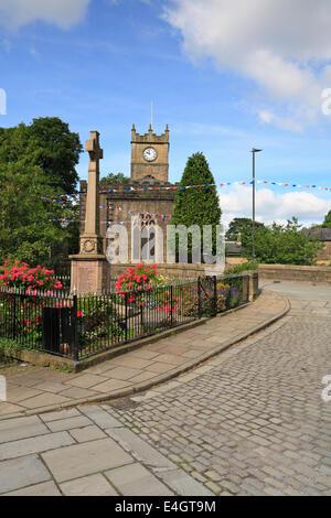 War Memorial Cenotaph and St Matthew's Church in Hayfield,Peak District National Park, Derbyshire, England, UK. - Stock Photo