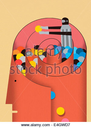 Male figure sorting colored balls inside of spiral in man's head - Stock Photo