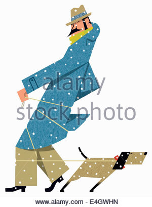 Dog tugging on leash wrapped round man in snow - Stock Photo