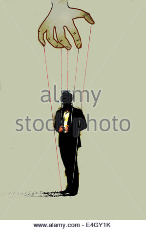 Hand controlling businessman on puppet strings - Stock Photo