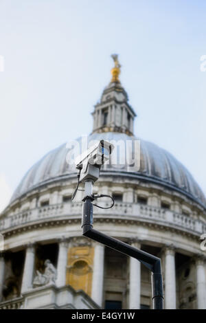A traffic congestion red light control CCTV camera shot from below, against the dome of St Paul's Cathedral, London, - Stock Photo