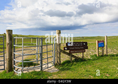 Metal gate access on visitor trail path to Aird an Runair peninsula in Balranald RSPB Nature Reserve North Uist - Stock Photo
