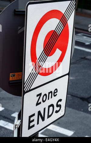 A 'Congestion Zone Ends' street sign in London UK C roundel - Stock Photo