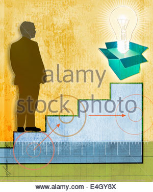 Businessman on staircase looking at light bulb emerging from box - Stock Photo
