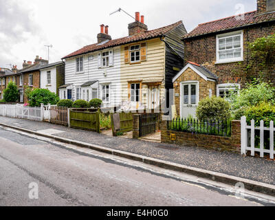 Typical  Victorian terraced cottages in good and poor state of repair next to Twickenham Green, Greater London, - Stock Photo
