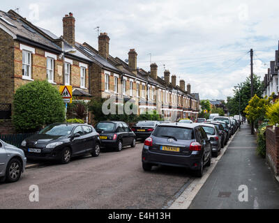 Typical terraced VIctorian Cottages in a narrow suburban street, Twickenham, London, UK - Stock Photo