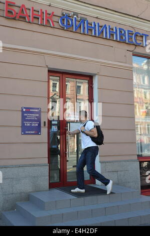 ITAR-TASS: ST PETERSBURG, RUSSIA. JULY 7, 2014. An outside view of a Fininvest Bank office, one of the banks that - Stock Photo