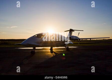 Piaggio P.180 Avanti Airplane on the Tarmac at Sunrise, Sunset in Florida - Stock Photo