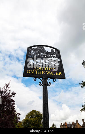 Bourton on the Water village sign Cotswolds UK England - Stock Photo