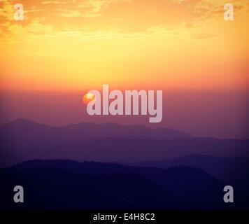 Vintage retro effect filtered hipster style travel image of sunset in Himalayas. Shimla, Himachal Pradesh, India - Stock Photo
