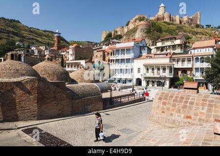 Abanotubani baths district and Nariqala citadel in Old Tbilisi, Georgia - Stock Photo