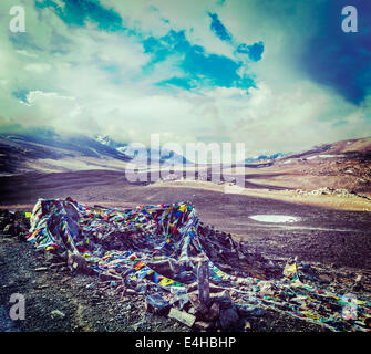Vintage retro effect filtered hipster style travel image of Buddhist prayer flags (lungta) on Baralacha La pass - Stock Photo