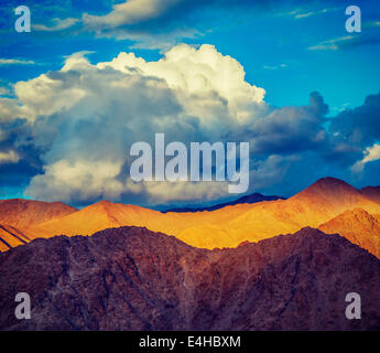 Vintage retro effect filtered hipster style travel image of Himalayas mountains on sunset. Ladakh, Jammu and Kashmir, - Stock Photo