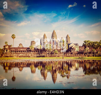 Vintage retro effect filtered hipster style travel image of Cambodia landmark Angkor Wat with reflection in water - Stock Photo