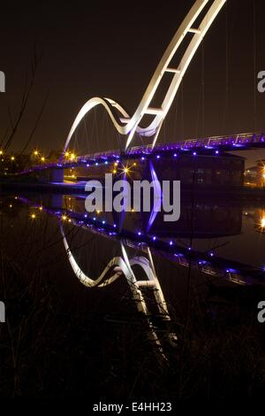 Infinity Bridge in Stockton On Tees reflected on the river below