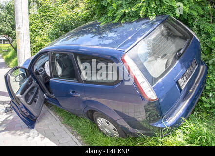 Wrecked car in the city, frontal damage - Stock Photo