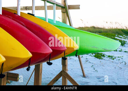 Colorful rental kayaks stored on a rack at a Key Biscayne beach in Miami, Florida, USA. - Stock Photo
