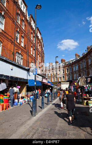 LONDON, UK - AUGUST 20TH 2013: The famous Electric Avenue in Brixton, London on the 20th August 2013.  Electric - Stock Photo