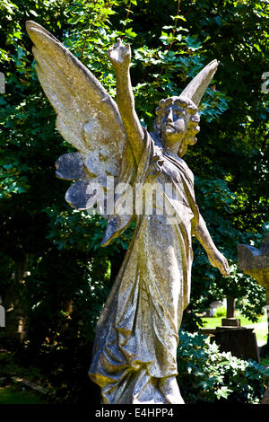 Angel sculpture in Highgate Cemetery, London. - Stock Photo