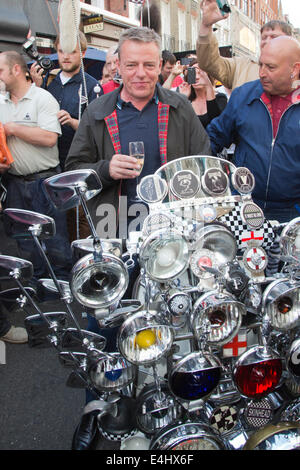 65th Anniversary Celebrations of Bar Italia in Frith Street, Soho, London, Suggs poses with a mod's motorbike - Stock Photo