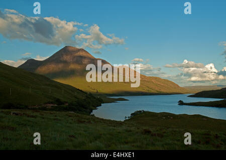 Evening sunlight over Cul Beag and Loch Lurgainn - Stock Photo