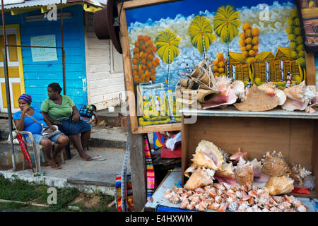Colorful paintings, shells, and crafts on display in Bocas Town on Isla Colon, Bocas del Toro, Panama. Souvenir - Stock Photo