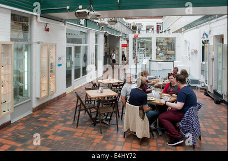 People socialise inside the Manchester Craft and Design Centre on Oak Street in the Northern Quarter, Manchester - Stock Photo