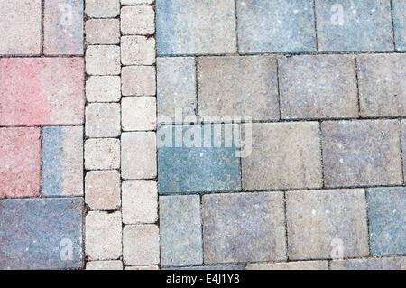 Three different brick paviers on a patio. - Stock Photo