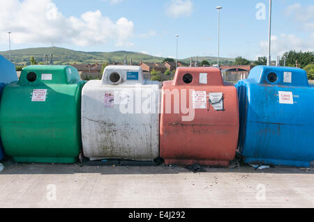 Glass and cans recycling bins - Stock Photo