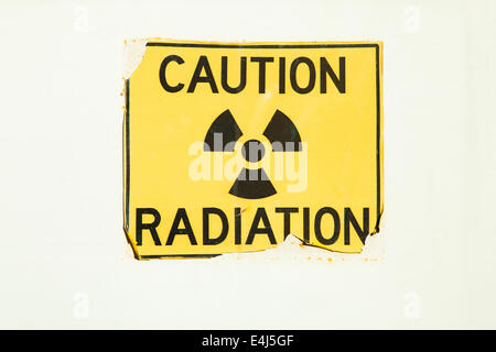 An old radiation warning sign on a door - Stock Photo