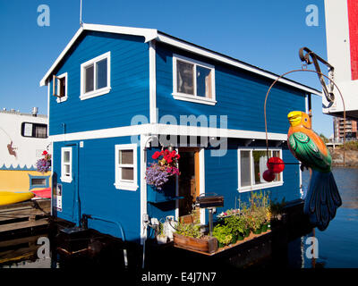 A beautiful blue houseboat (float home) moored at Fisherman's Wharf in Victoria, British Columbia, Canada. - Stock Photo