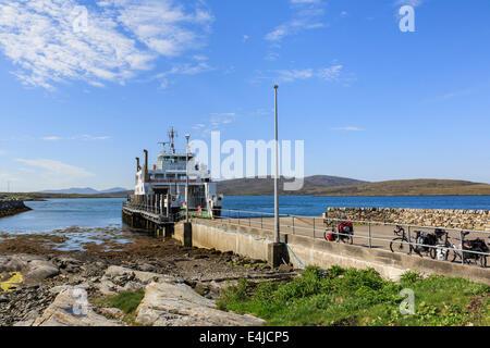 Caledonian MacBrayne passenger car ferry Loch Portain to Leverburgh on Isle of Harris docked at Borve pier on Berneray - Stock Photo