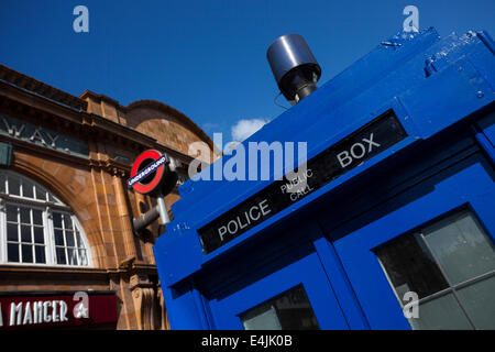 LONDON - JUNE 11, 2014: Public call police box with mounted a modern surveillance camera near Earl's Court tube - Stock Photo