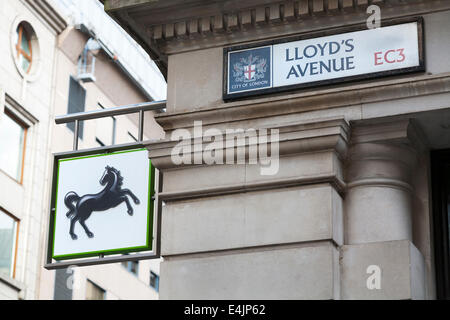Lloyds / Lloyd's bank sign / logo at their branch on the corner of Lloyd's Avenue and Fenchurch street in the city - Stock Photo