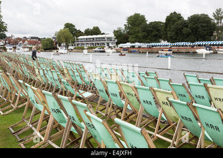 Rows of empty deckchairs for spectators at Henley Royal Regatta, labelled HRR, Henley-on-Thames, Oxfordshire, UK - Stock Photo