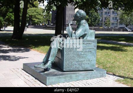 Statue of resistance fighter Jan Karski in Warsaw - Stock Photo