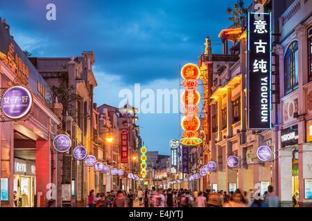 Pedestrians pass through Shangxiajiu Pedestrian Street. - Stock Photo