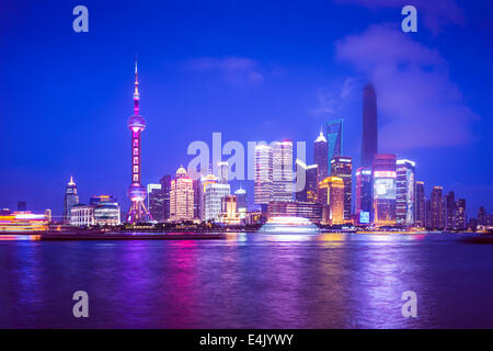 Shanghai, China view of the Pudong financial district from across the Huangpu River at night.