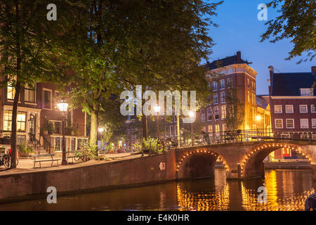 Amsterdam Canal romantic bench from The Fault in Our Stars TFiOS on the Leidsegracht Canal at night evening Amsterdam - Stock Photo