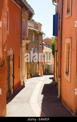 Little lane with red houses in French Roussillon - Stock Photo