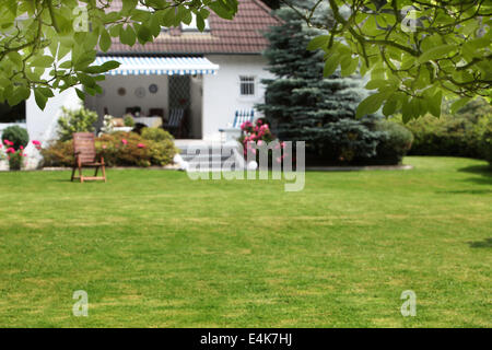 Small house with beautiful garden - Stock Photo