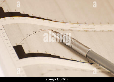 pencil on the printed graph paper - Stock Photo